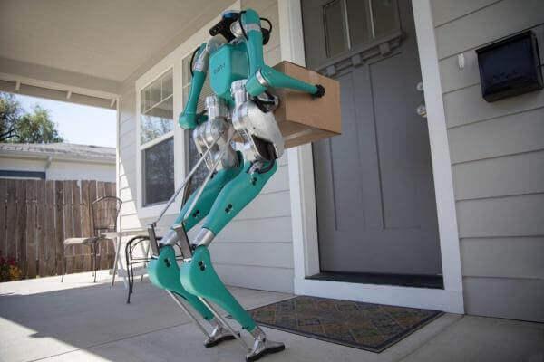 Ford доставлятиме пакунки за допомогою безпілотного авто та двоногого робота