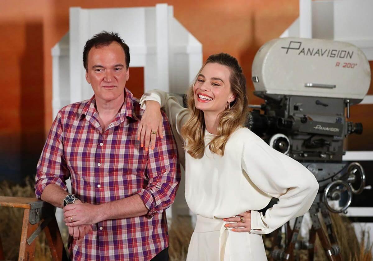 Квентін Тарантіно та Марго Роббі на заході присвяченому фільму «Одного разу в Голлівуді».